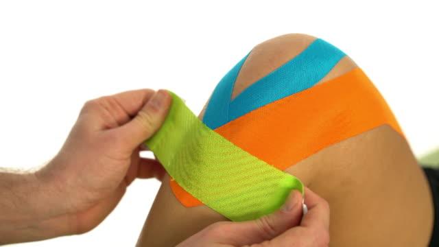 closeup taping knee