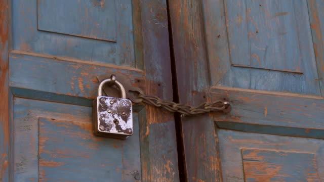 Closeup view of padlocked door