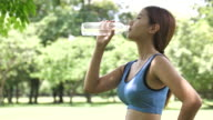 Close-up Woman drinking water after sport activities
