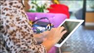 Close-up woman hands using digital tablet computer ipad touchscreen