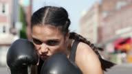 Close-up Woman kickboxing in street/ Manhattan, New York, USA