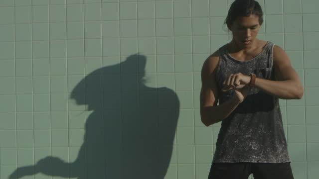 Closeup young man boxing with shadow