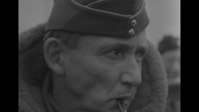 VS closeups of British Field Marshal Bernard Law Montgomery Marshal of the Royal Air Force Arthur William Tedder with pipe Supreme Commander of the...
