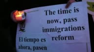 Closeups of candles and signs while immigrants from Colombia and Ecuador representing Members of New Yorkers For Real Immigration Reform gather to...