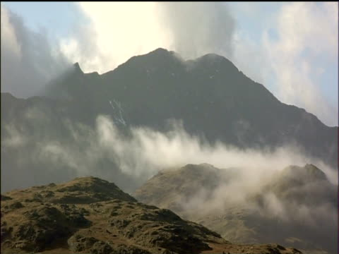 Cloud drifting in valley mountains in background Snowdonia National Park