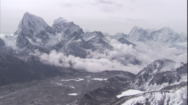 Cloud drifts between snowy peaks, Himalayas, Nepal Available in HD