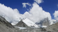 Cloud drifts over Himalayas and glacier, Tibet, China