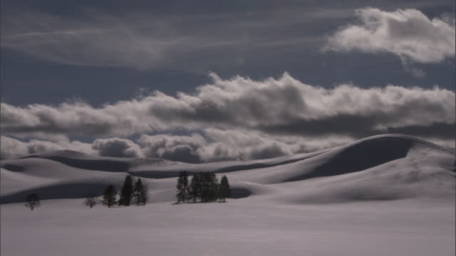 Cloud drifts over snow covered hills, Yellowstone, USA
