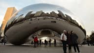 Cloud Gate a public sculpture by Indianborn British artist Anish Kapoor that is on display in Millenium Park in Chicago Illinois Medium Shots of...
