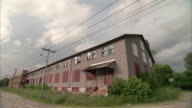 WS Clouds above abandoned, dilapidated industrial building / Rutland, Vermont, USA