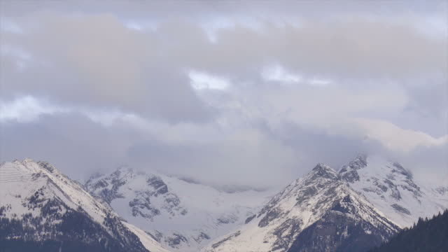 Clouds above Alpine Winter Mountains Time Lapse