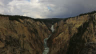 TIME LAPSE WIDE SHOT clouds become darker over Lower Yellowstone Falls and Yellowstone River in the Grand Canyon of the Yellowstone