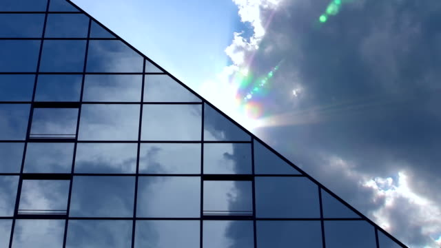 Clouds Behind Skyscraper - rays of sunlight /time lapse
