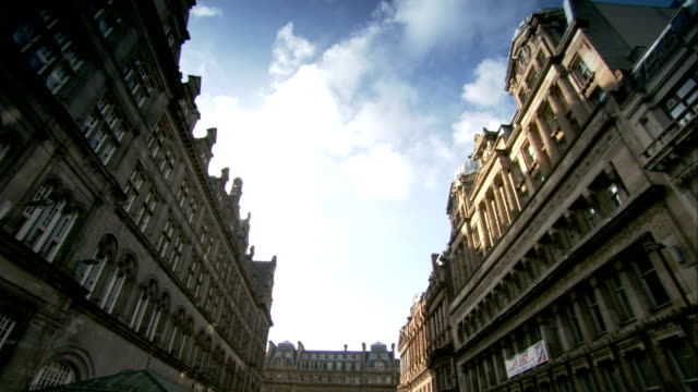 Clouds drift above the Trades Hall and City Chamber buildings in Glasgow, Scotland. Available in HD.