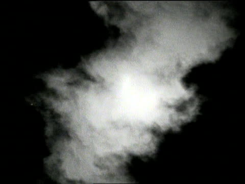 Clouds drift in front of a solar eclipse