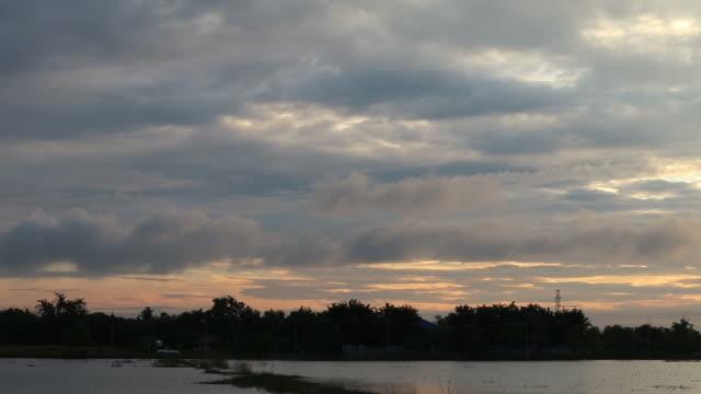 Clouds drift over rural floods.