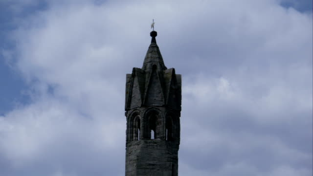 Clouds fill the sky behind a castle spire. Available in HD.