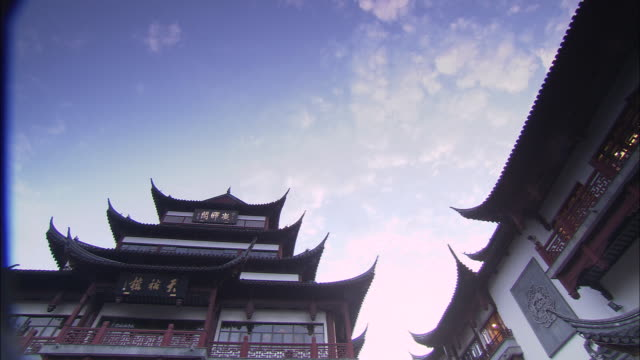 Clouds float over the pagoda roofs of Ju Yuan Market in Shanghai, China.