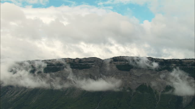 AERIAL WS Clouds floating below escarpment near Grenoble / Isere, France
