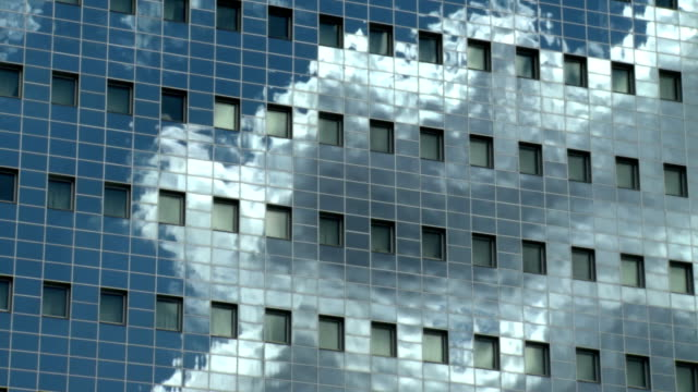 Clouds in reflection on the office building