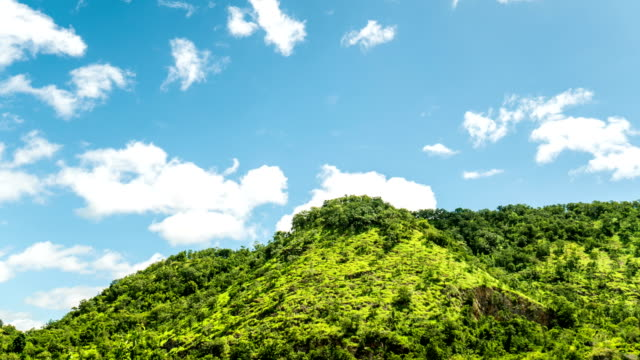 Clouds motion passing over green tropical mountain, Time lapse