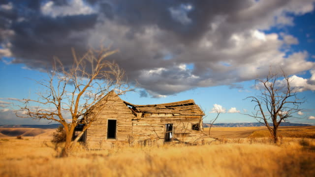 Clouds move past an old, abandoned homesteader cabin in eastern Washington state, time lapse