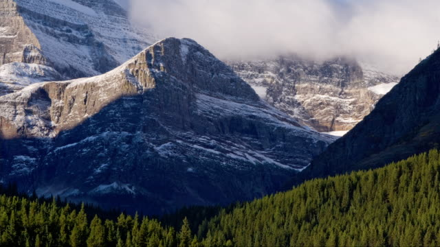 T/L WS Clouds moving above Cataract Mountain near forest in Glacier National Park / Montana, USA