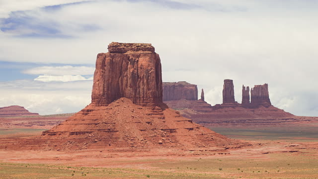 WS T/L Clouds moving over rock formations in landscape / Monument Valley, Utah, USA