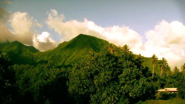 Clouds moving over tropical hill in Tahiti