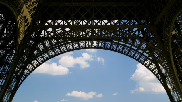 Clouds pass behind the Eiffel Tower.