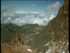 Clouds pass over mountain peak in Aberdare Range, Kenya