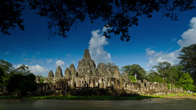 WS T/L Clouds passing over bayon temple / Angkor, Siem Reap, Cambodia