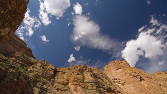 WS T/L Clouds passing over canyon rock face in desert / Superstition, Arizona, United States