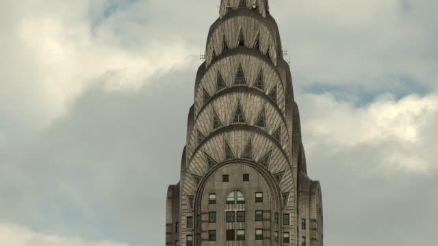 Clouds roll behind the tower of the Chryster Building in New York City.