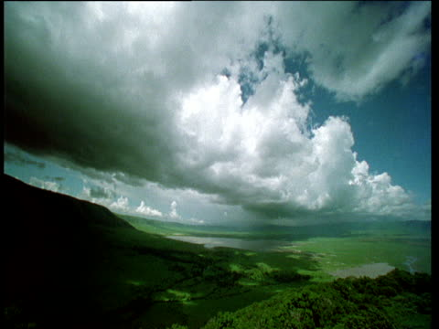 Clouds roll over African savanna, lush and green