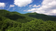 Clouds roll past the scenic green mountains of Blue Ridge Parkway in Asheville, North Carolina, timelapse
