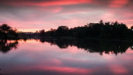 Clouds scud over coast at sunset