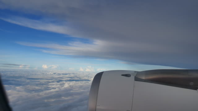 Clouds seen through the window of  airplane