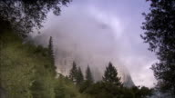 Clouds surround the El Capitan cliff in the Yosemite National Park.