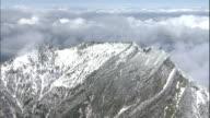 Clouds surround the snowy summit of Mt. Ishizuchi and the Ishizuchi-Jinja Shrine.
