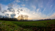 HD TIME-LAPSE: Cloudscape Over A Meadow