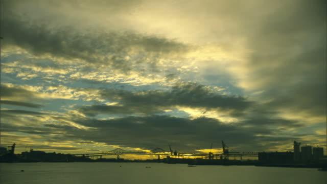 WS, Cloudscape over Boston harbor at sunset, Boston, Massachusetts, USA