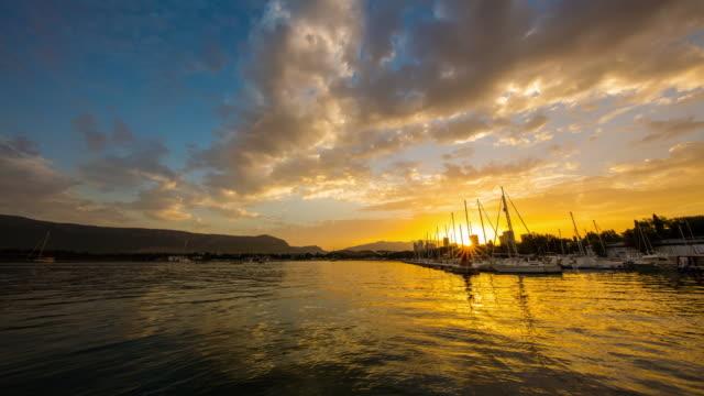 T/L Cloudscape over the marina at sunrise