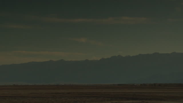 A cloudy sky outlines silhouetted mountains in Mexico's Baja California Desert.