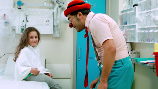 Clown  amuses the girl in hospital
