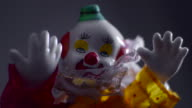 A clown doll in spooky lighting