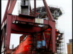 LIB SCOTLAND Clyde Govan Shipyard LA MS Gantry slowly towards LA BV Worker on scaffolding passing up equipment MS Workers standing LA GV Shipyard...