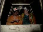 All party report Wellbeck CMS Two miners sitting side by side in small underground train