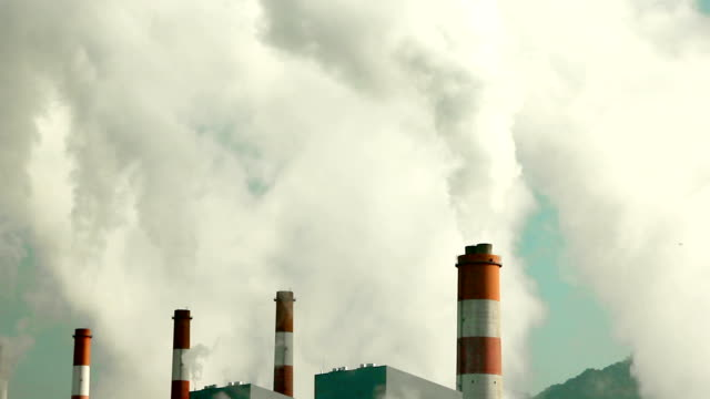 Coal fired power station with smoke stack