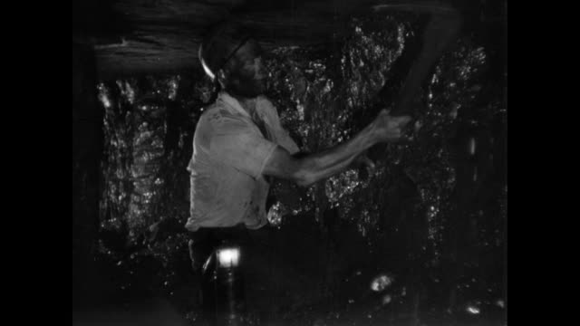 MONTAGE Coal miners working underground / United Kingdom